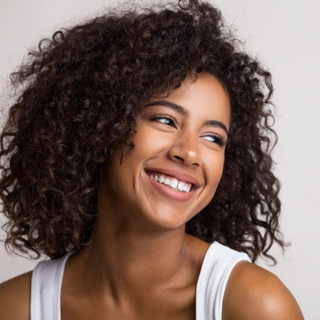 Beauty portrait of happy african american woman on light panorama background with empty space